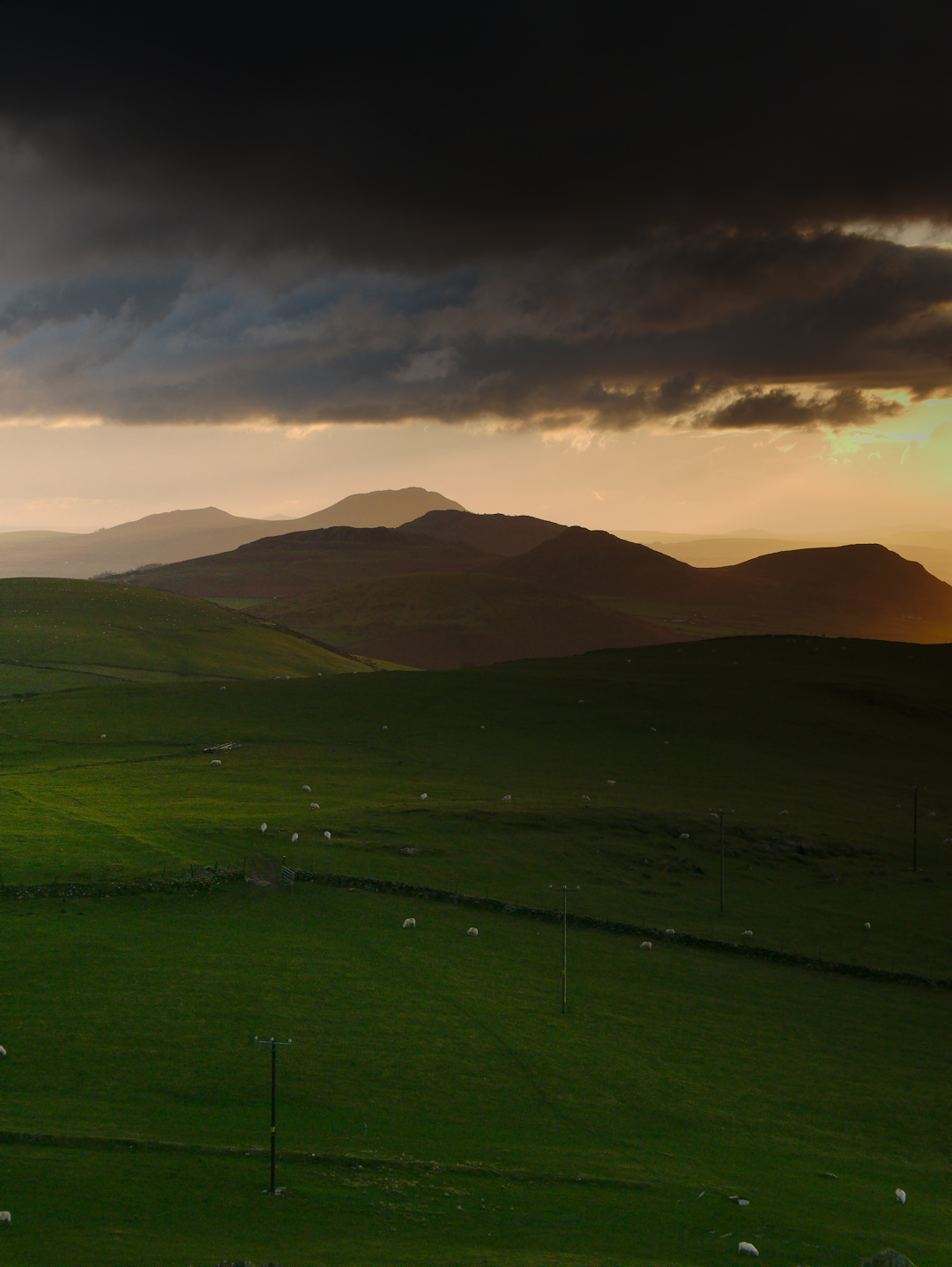Llyn Peninsula Sunset with Farmland and Mountains